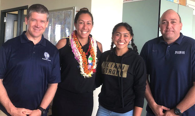 Coaches Kevin OʻBrien, Alex Akana, and Kaholo Rickard with sophomore Sofia Stupplebeen.