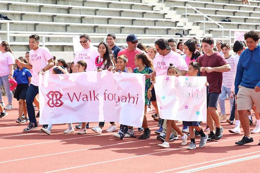 Staff and students begin the 2-lap Walk for Pauahi, October 18, at Kana'iaupuni Stadium. Senior Māhie Borge coordinated the event, which included speakers, entertainment, and games in addition to the walk.