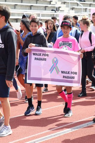 Seventh graders Kekilinahe Ting and Reel Yoshida express gratitude for Pauahi Bishop, the schoolʻs founder who died of breast cancer, at the Walk for Pauahi.