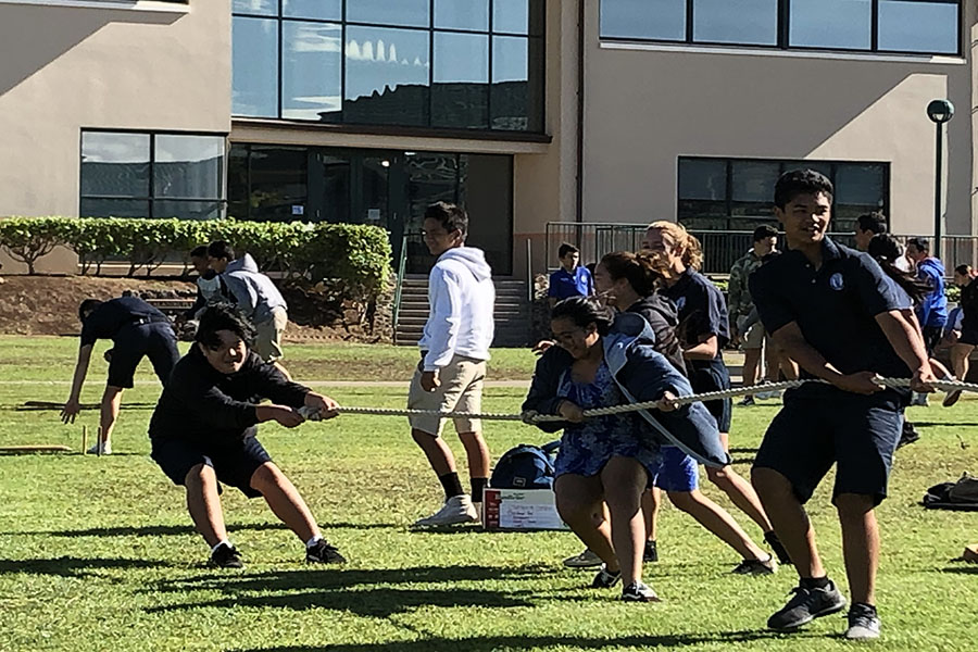 Freshmen Kenji Masuda, Po'okela Aiu and Shayana DeRego Ho'opai play hukihuki in the quad during their flex time, November 20. Flex time is a flexible block of time when students can meet with get work done, meet with teachers or socialize and build pilina.