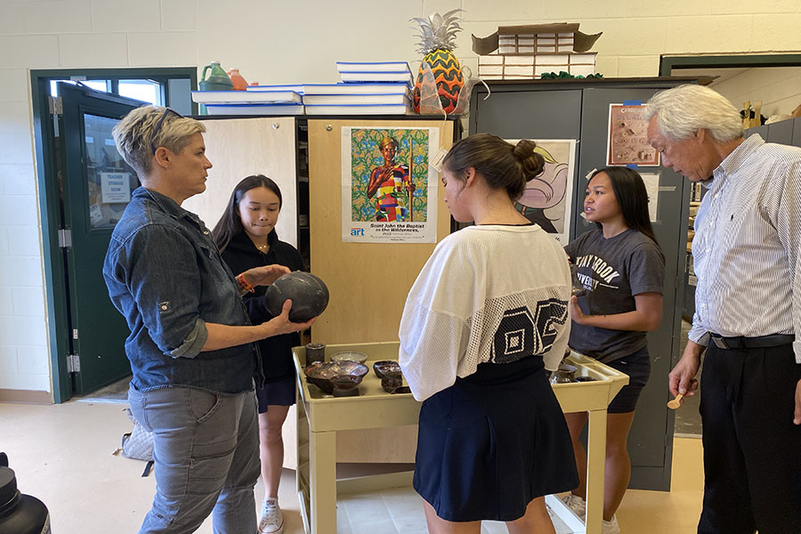 Mrs. Guntzel shows Christiana Alo, Skye Kaina, Makenna Robinson, and Kahu Wong the raku-fired pieces from the special firing process done today as part of the Ceramics 2 class.