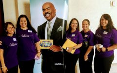 Coach Lemoe Tua's family poses next to a picture of Family Feud host Steve Harvey at the Family Feud auditions on Oʻahu. The Tuaʻs will be filming in California over Spring Break.