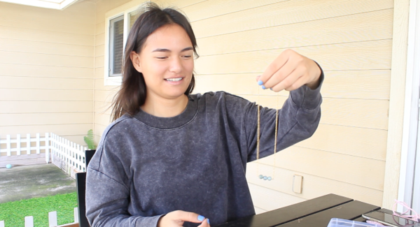 Caitlyn Duarte shows off one of the necklaces she made during our interview. Her company, Naleiko Jewelry, is the fulfillment of one of her dreams.